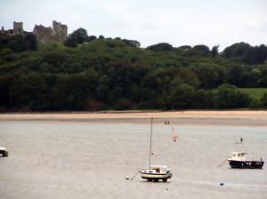Boats and surfers on the Towy